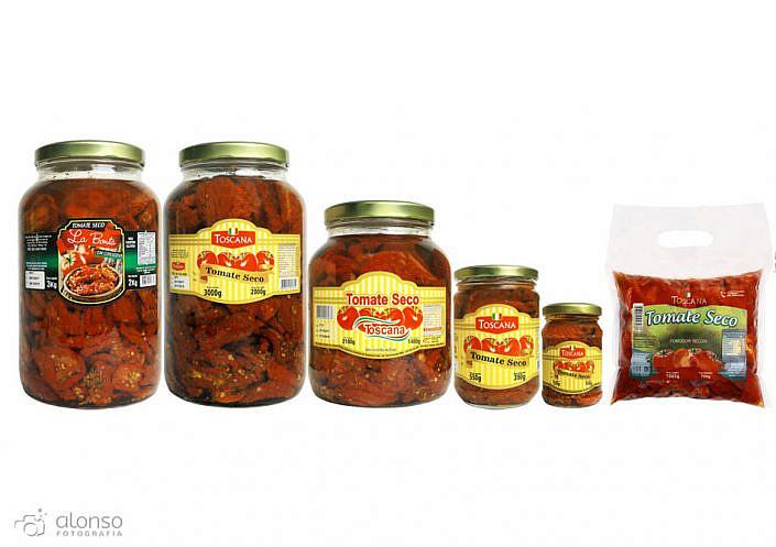 Tomate seco toscana em vidro fotografia de produto